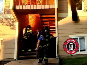 video.-united-states:-the-fire-of-a-residence-filmed-from-the-inside,-a-girl-taken-out-of-the-flames-by-a-firefighter