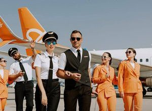 Photo of No more skirts and heels!  An airline will dress its hostesses in pants and sneakers